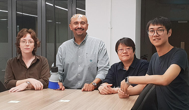 Ms Jennifer Dodgson (far left) and her teammate Mr Pei Junjie (far right) co-founded Vox Dei, a text analytics software startup that makes research analysis easier.